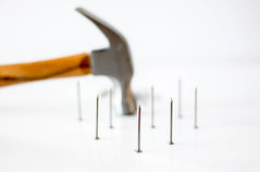 hammer with Nails on a White Background close-up