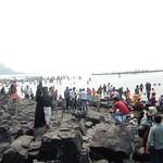 People on the shore near Haji Ali Mosque