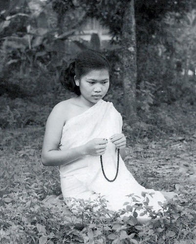 Photo from Meditation Exhibition - a young nun at a meditation retreat in Luang Prabang in the 1950s. Courtesy of BHP