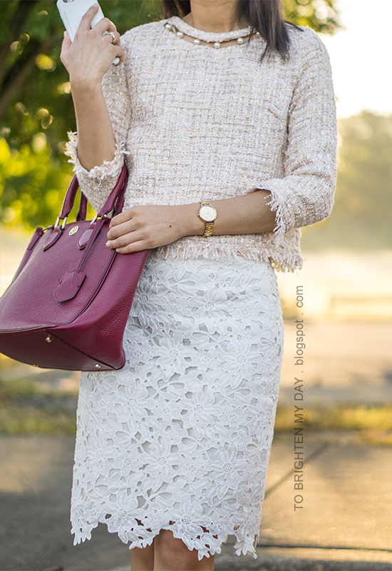 light pink tweed top with pearls, white lace pencil skirt, gold watch, burgundy tote