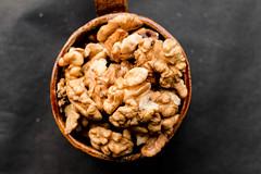 Walnuts in a ceramic cup , top view