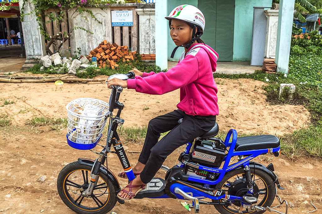 Girl on scooter--Thuan Nam