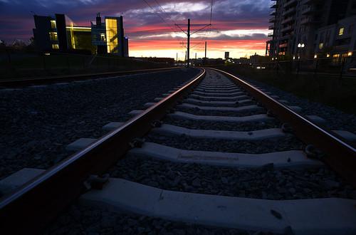 city light rail lightrailtransit lrt waterloo ontario canada railtracks earlymorning sunrise perimeterinstitute cooperageapartments pretty lovely clouds fence beautiful