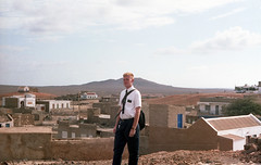 Tom standing on road in town of Sal