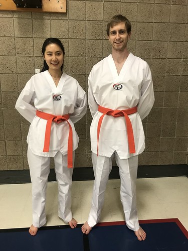 New Orange Belts! Ms. Kathleen and Mr. Michael Reitz recently completed their promotional testing requirements. Congrats to you both! We are proud of you.
