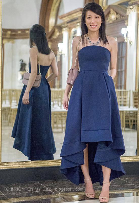 gemstone necklace, navy strapless high low dress, nude shoulder bag, nude heels