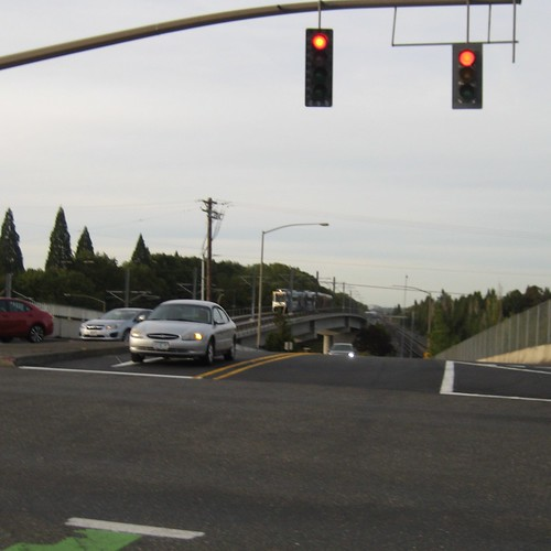 An Oak Grove-bound train on the bridge north of Tacoma Street