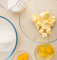 Flour, eggs, egg yolks, butter and milk as part of yellow cake ingredients.