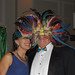 Guests and contributors Carol Arnott-Robbins and Tucker Robbins, of Robbins Real Estate, embrace the spirit of the masquerade at the Green and White Scholarship Ball.