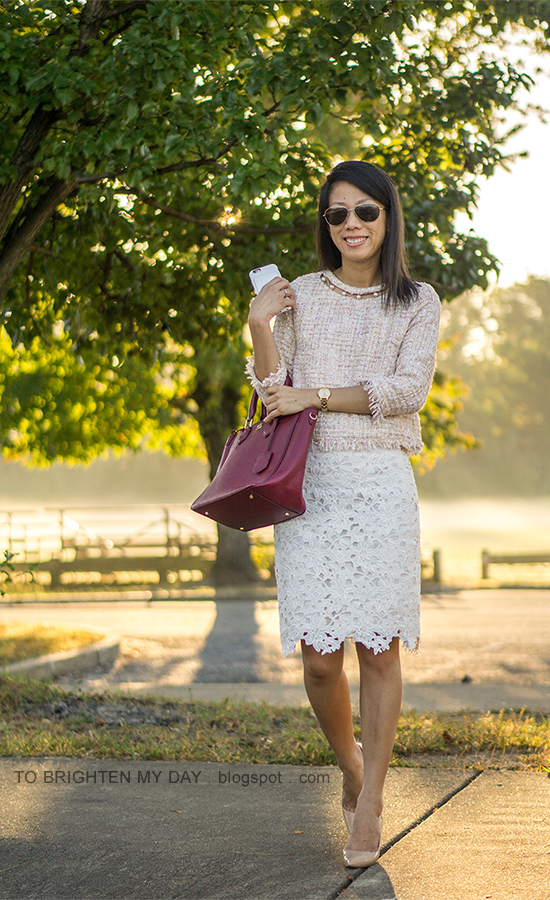 light pink tweed top with pearls, white lace pencil skirt, gold watch, burgundy tote, nude pumps