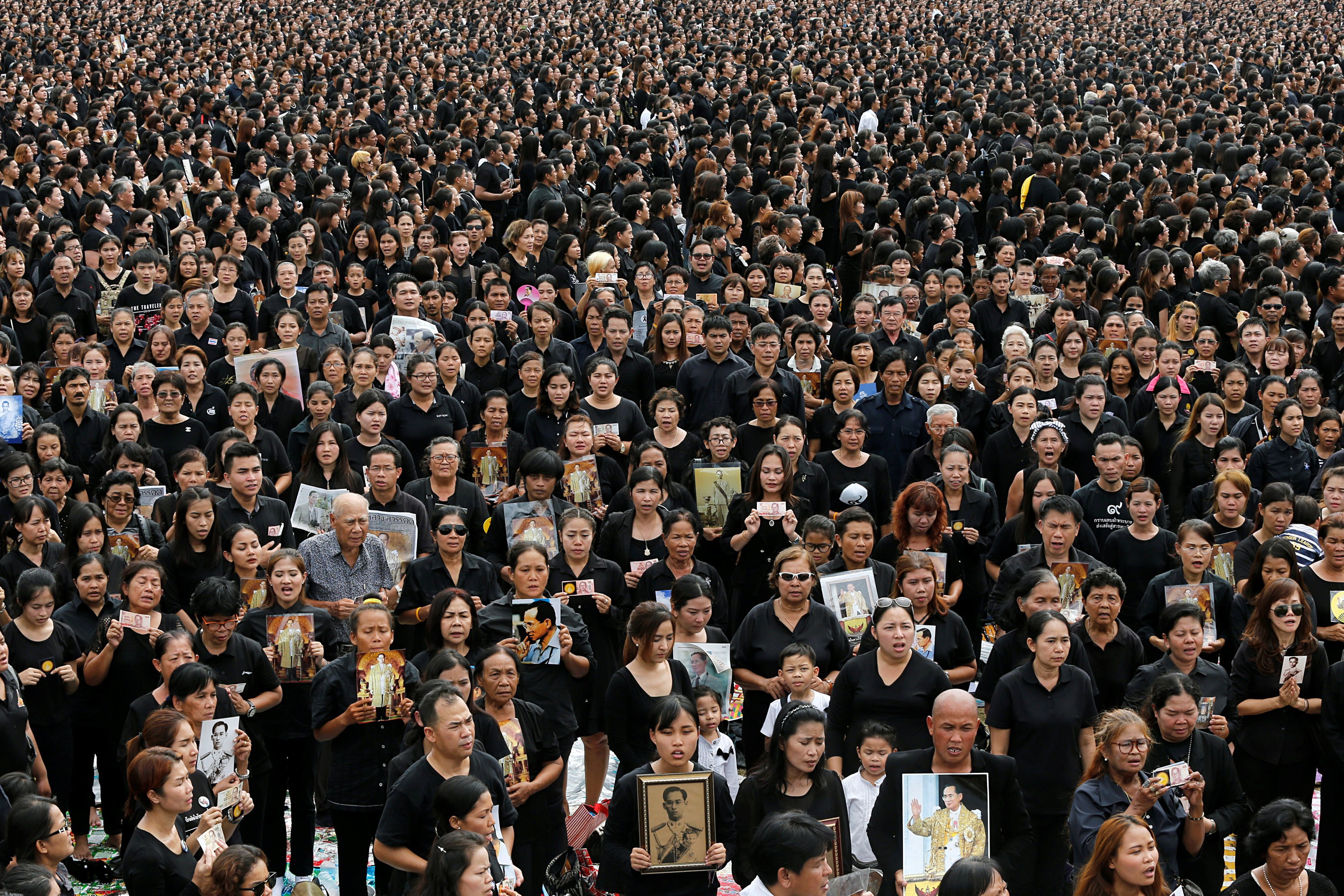 An estimated 500,000 mourners gathered at Sanam Luang Ceremonial Ground in Bangkok on October 22, 2016, for a mass singing of the Thai National Anthem. Photos courtesy of Reuters