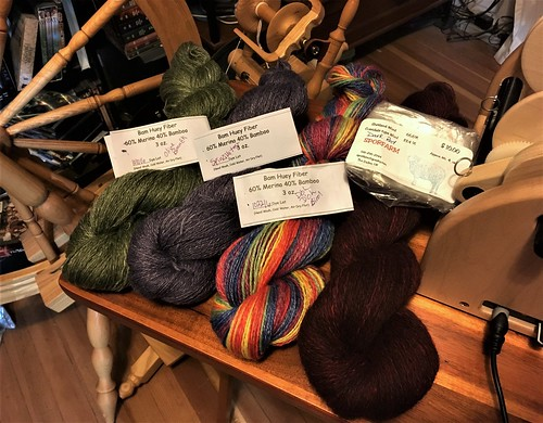 Spinzilla 2017, Day 5:  PLYING.  3 oz Bam Huey Olive Branch, 3 oz Bam Huey Spinzilla Test Purple, 3 oz Bam Huey D'oh D'oh Bird, 4 oz SporFarm Dark Red
