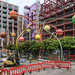 One of the world's most prominent balls-on-stems public sculptures, amid construction workers.