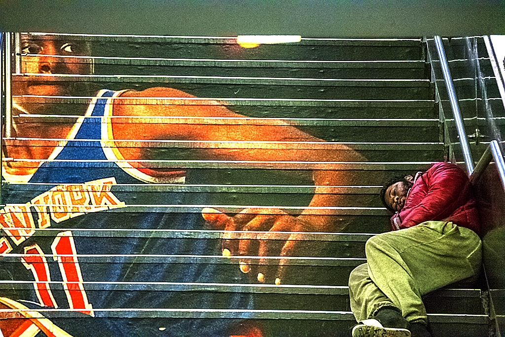 Knicks player and homeless man, sleeping--Manhattan