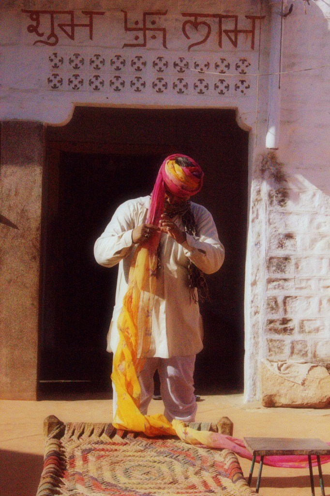 Man tying his turban in rural Rajasthan