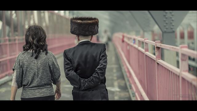 Hasidic Jews walk across the Williamsburg Bridge to Manhattan