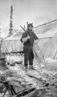 J.F. Fredette, first assistant with cook tent in background / J.F. Fredette, premier assistant, et tente du cuisinier en arrière-plan