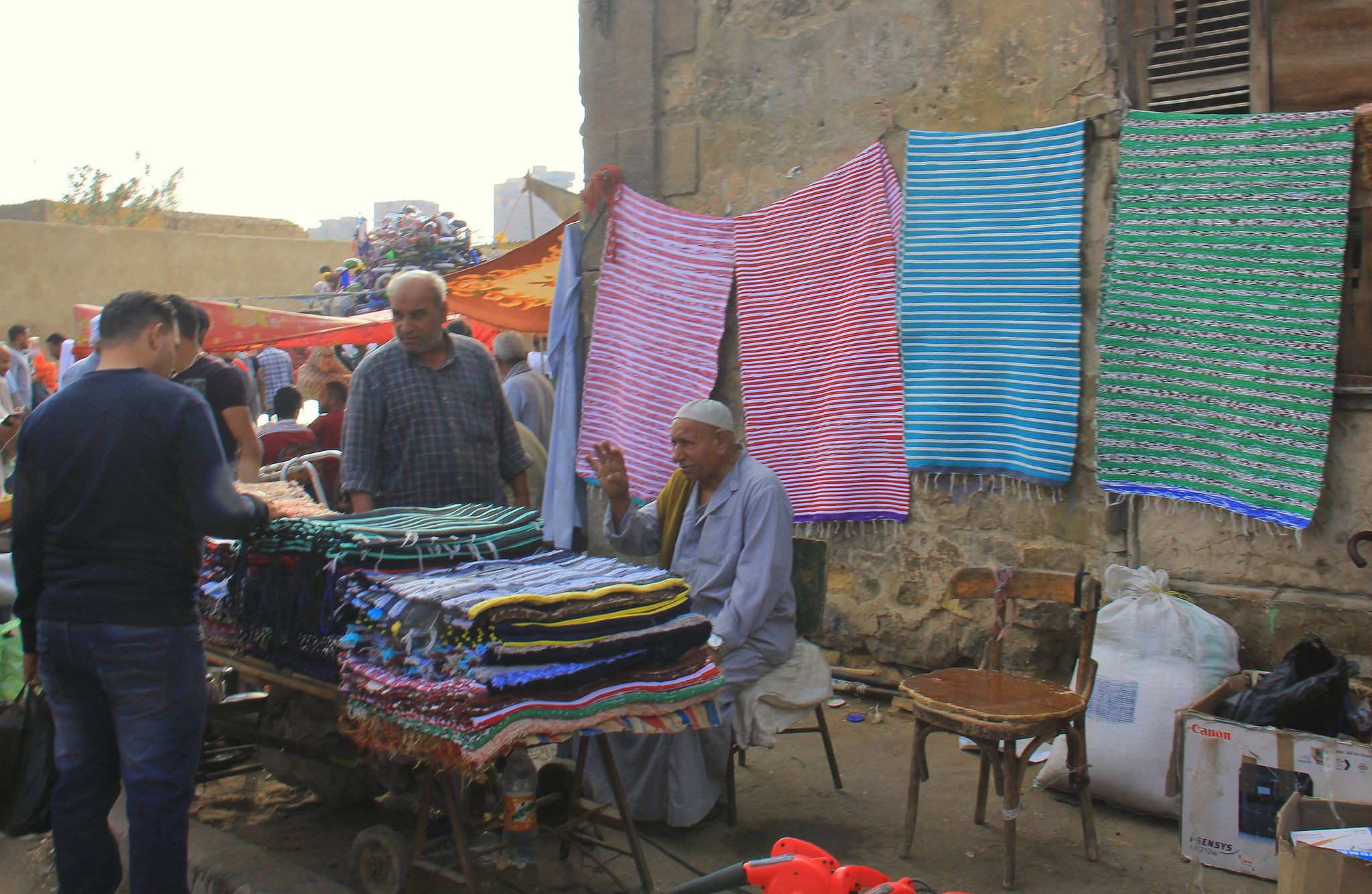 Rug seller bargaining at Friday Market