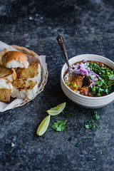 Pav Bhaji - a mishmash of mixed vegetable cooked in warm spices, served with soft butter rolls.