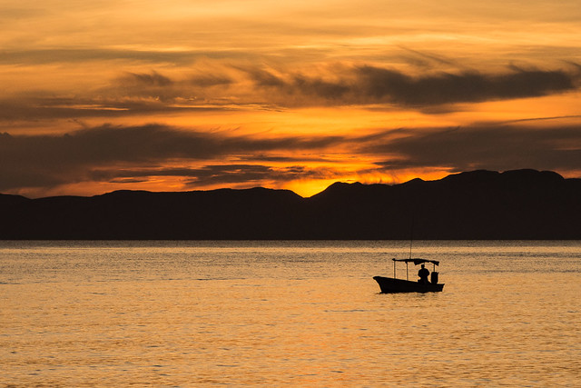 sunrise and fishing boat