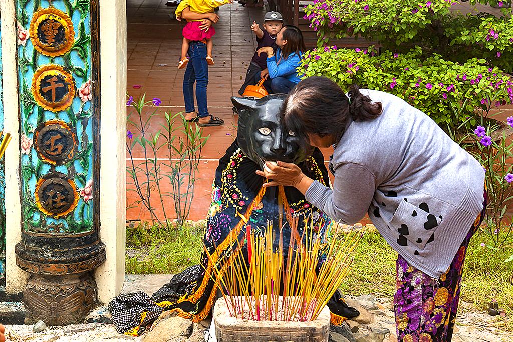 Feeding the statue of the sacred black tiger--La Gi