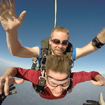 Videographer Jeff McCarty Docking Onto Tandem Skydiver Chris In FreeFall.  Featuring Instructor Nate Plumb