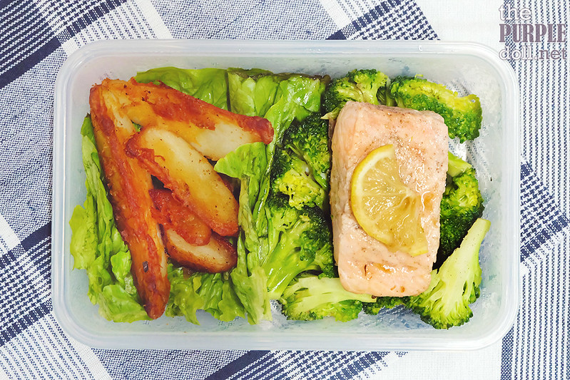 Salmon, potato wedges, broccoli and greens