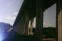 train under bridge
