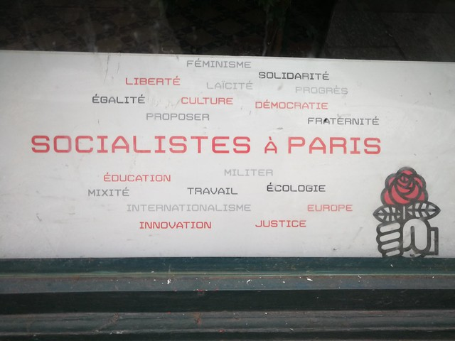 Sign in the window of Parti Socialiste Paris