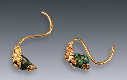 This gold jewelry with turquoise was probably meant to be worn on someone's ears. From livescience.com