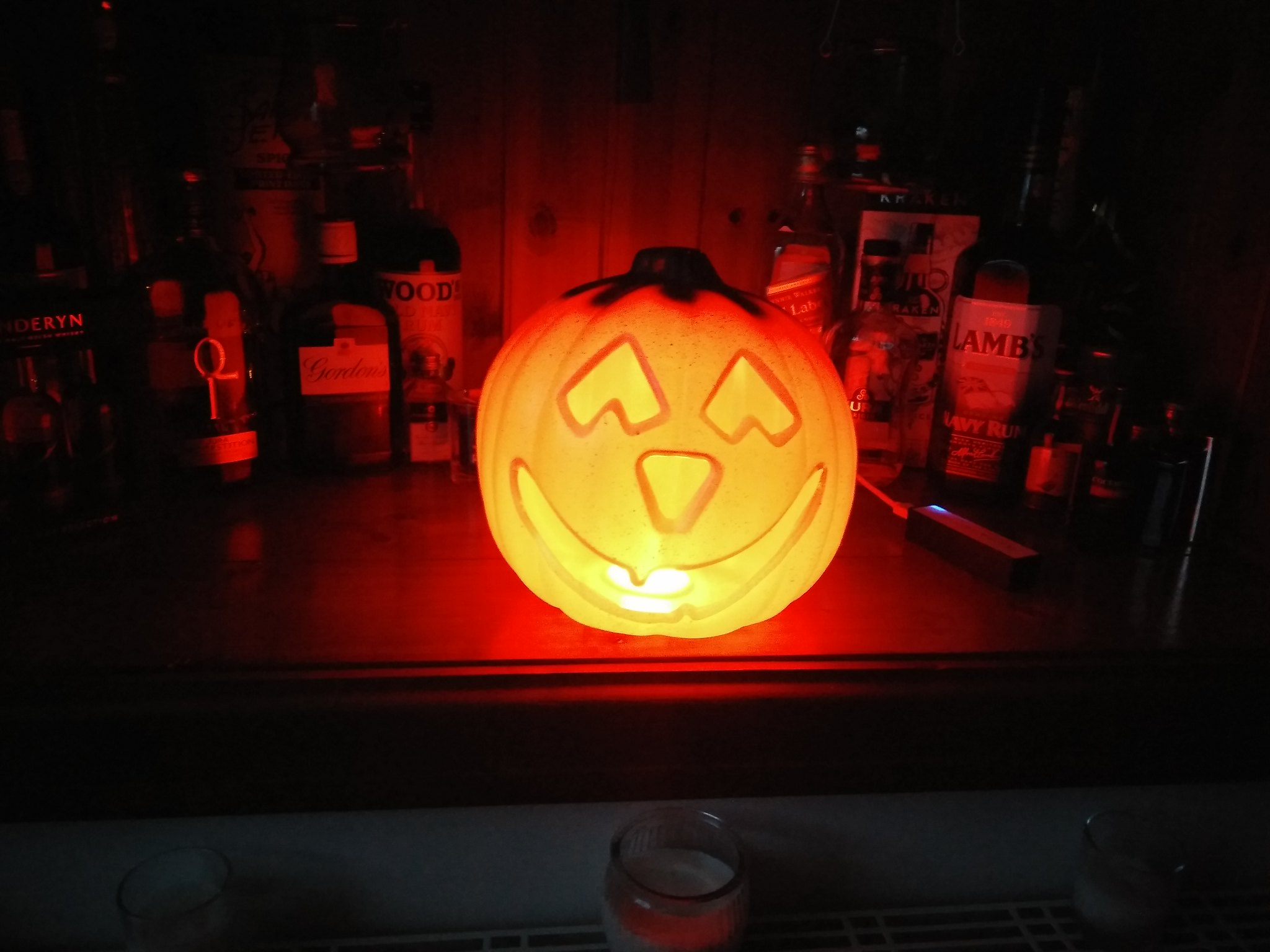 A pumpkin lit up with neopixels