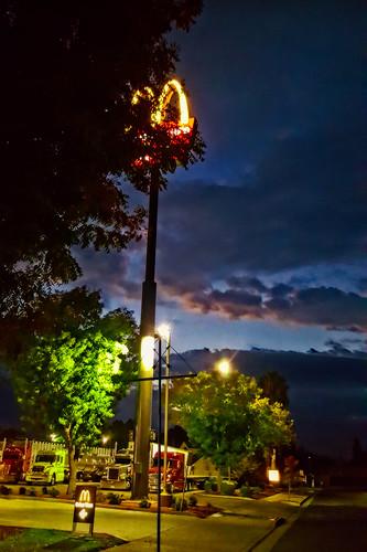 mcdolds davemeyer kingsburg sky sign trucks dark sunrise