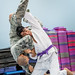 Tech Sgt. Jessie Sosa, a Special Air Missions Crew Chief with the 89th MXG/MXMA, demonstrates a jiu-jitsu throw for Senior Airman Anthony Vallejos and other members of the 811SFS Ravens at the JBA Tactical Fitness Center at Joint Base Andrews, Md., Oct. 10, 2017. Sosa, a practitioner of Brazilian Jiu-Jitsu, often has joint and muscle strains after competitions and back pain from long flight hours which he treats with Battlefield Acupuncture allowing him to avoid the use of pain medications which would necessitate his removal from operational flight status. (U.S. Air Force photo by J.M. Eddins Jr.)