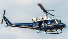 Bell UH-1N Iroquois (69-6668) Serves as a Camera Platform for Photographers Taking Pictures of Airshow Crowd