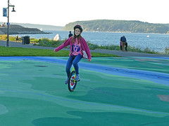 Unicycling on new mural at Point Ruston