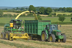 John Deere 7550 SPFH filling a Thorpe Trailer drawn by a John Deere 6930 Tractor
