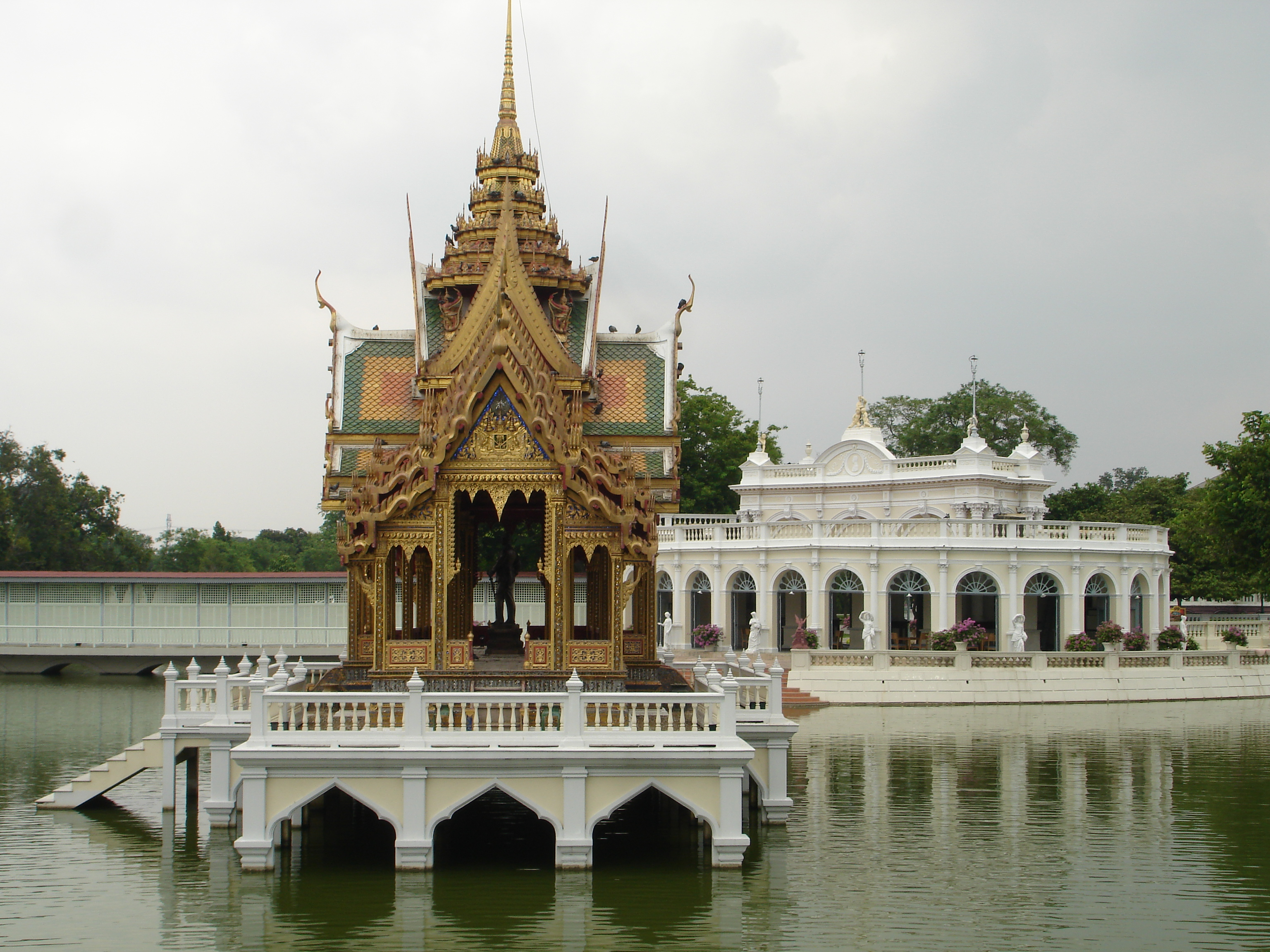 Phra Thinang Aisawan Thiphya-Art Pavilion in the Outer Palace compound at Bang Pa-In Royal Palace. The covered bridge to shield ladies of the court leading to the Inner Palace can be seen in the left background. Photos taken by Mark Jochim on May 16, 2006.