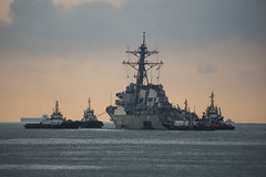 USS John S. McCain (DDG 56) is towed away from the pier at Changi Naval Base to meet heavy lift transport vessel MV Treasure, Oct. 5. (U.S. Navy/MC2 Joshua Fulton)