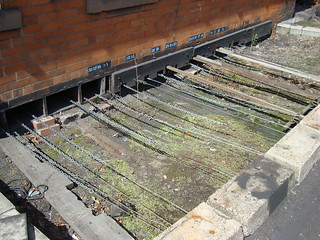 A close look at the chains and cables coming from under Loughborough signal box on the Great Central Railway