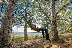 eno hammocks out in nature - landscape scenes with people