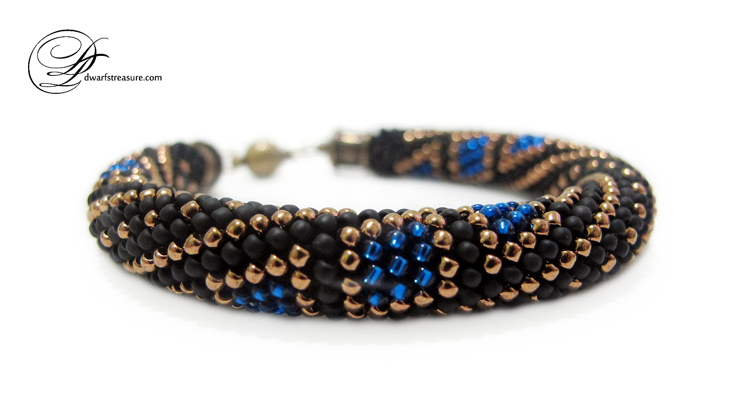 Glamorous black and blue beaded crochet bangle