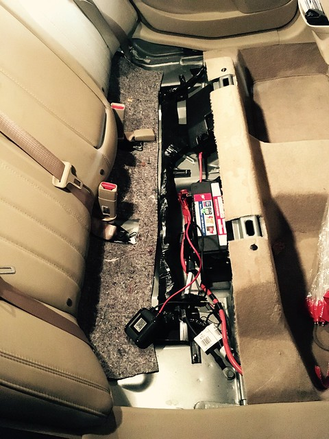 Crazy car battery location: under the back seat in my car. I came home from a recent vacation and my car wouldn't start. AAA service guy couldn't find the battery under the hood of the car. I had to tell him it was in the back seat. He couldn't believe me