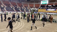 The 25 riders who were called back to ride-off for the finals, study the course. With the National Horse Show Foundation, and Caroline Babylon, of the 4H Therapeutic Riding Program of Carroll co. at the Pennsylvania National Horse Show on Oct. 15, 2017.