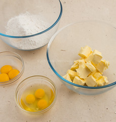 Cake flour, chopped unsalted butter at room temperature, three eggs and three egg yolks.