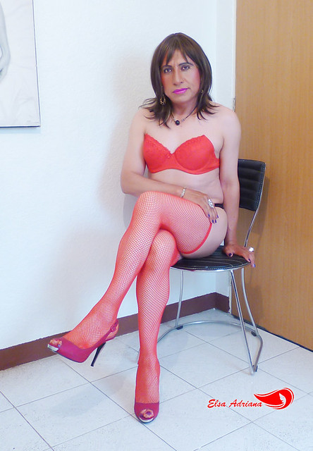 Red bra, black panties, red net stockings, red open toe with silver heel.