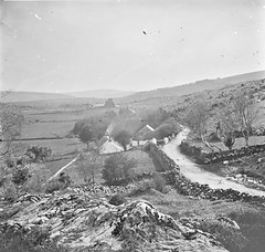 """""""Long shot, rocky fields, hills slated cottages spare trees"""" is Lough Dan, County Wicklow"""