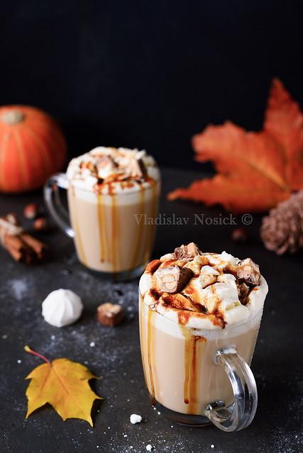 Pumpkin Caramel Spice Latte on black background