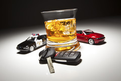 Highway Patrol Police and Sports Car Next to Alcoholic Drink and Keys