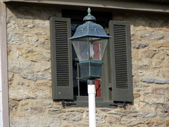 Lamp Post And Window Shutters.