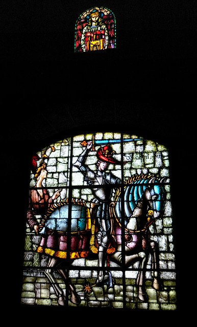 A stained-glass window featuring a knight in armour on horseback in the Segovia Castle in Spain